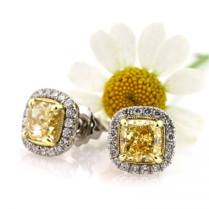 2.52ct fancy yellow cushion cut diamond stud earrings | Mark Broumand