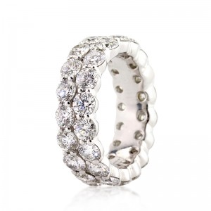 5.03ct Round Brilliant Cut Diamond Eternity Band Angled View | Mark Broumand