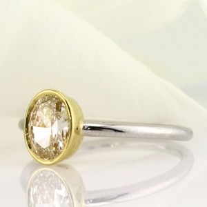 1.06ct Fancy Light Yellow Oval Cut Diamond Engagement Ring | Mark Broumand